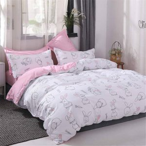 ropa de cama infantil rosa y blanco con conejos